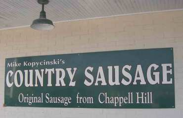 A sign promotes country sausage by Mike Kopycinski so I order the...